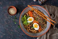 Japanese miso ramen noodles with eggs, carrot and mushrooms. Soup delicious food. Flat lay. Top view Royalty Free Stock Images