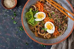 Japanese miso ramen noodles with eggs, carrot and mushrooms. Soup delicious food. Flat lay. Top view Royalty Free Stock Photography