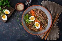 Japanese miso ramen noodles with eggs, carrot and mushrooms. Soup delicious food. Flat lay. Top view Royalty Free Stock Photos
