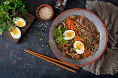 Japanese miso ramen noodles with eggs, carrot and mushrooms. Soup delicious food. Flat lay. Top view Stock Images