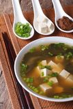 Japanese miso soup and ingredients close-up. Vertical Stock Photo