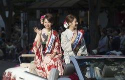 Japanese Misses on car during Nagoya Festival, Japan. Portrait of Japanese Misses riding in the Toyota cabriolet during 62nd Nagoya Festival in Japan Stock Photo