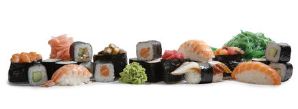 Japanese mix sushi. And rolls on white background Stock Photo