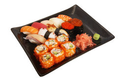 Japanese mix sushi. And rolls on plate Royalty Free Stock Photos