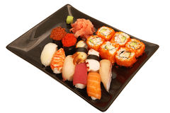 Japanese mix sushi. And rolls on plate Stock Images
