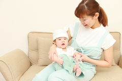 Japanese mom and her baby Stock Photos