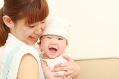 Japanese mom and her baby Royalty Free Stock Photo