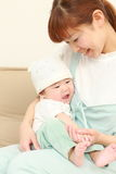 Japanese mom and her baby Stock Images