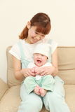 Japanese mom and her baby Royalty Free Stock Photos