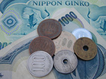 Japanese money. All the Japanese coins in use now and as background two 1000 yens bills Stock Photos