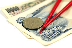 Japanese money and chopsticks Stock Images