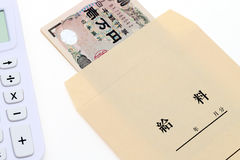 Japanese money in salary envelope Stock Photos