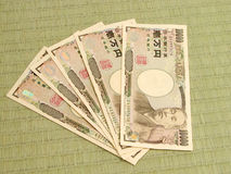 Japanese money on tatami floor. 50000 yens bills on a tatami floor