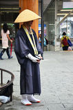 Japanese monk standing Stock Images