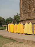 Japanese monks and nuns perform Buddhist rituals. SARNATH INDIA - 6 NOV 2009 - Japanese monks and nuns perform Buddhist rituals at Dharmeka Stupa at Sarnath stock image
