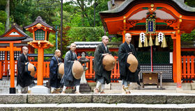 Japanese Monks at Shinto Shrine Stock Images