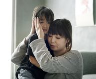 Japanese mother comforting her daughter Royalty Free Stock Image