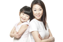 Japanese mother with daughter family portrait. Shot against white studio background Royalty Free Stock Photography