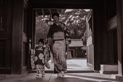 Japanese mother and a daughter in traditional kimonos in the Meiji Jingu Shrine in Tokyo royalty free stock images