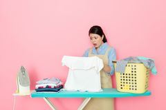 Mother feel shocked to see the dirty cloth Stock Image