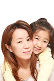 Japanese mother giving her daughter piggy back Stock Image
