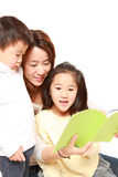 Japanese mother reading a book to her children Royalty Free Stock Photo