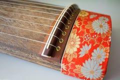 Japanese Motif Koto. Japanese fabric motif at a Koto. Koto is traditional Japanese stringed musical instrument similiar to Chinese zheng, the Mongolian yatga stock photography