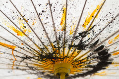 Japanese Mulberry Paper Umbrella Hand Painted with Yellow and Black Royalty Free Stock Photo