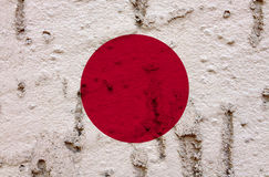 Japanese National Flag On Grunge Wall Background. National  Flag of Japn on Abstract Grunge Wall Background Royalty Free Stock Photo
