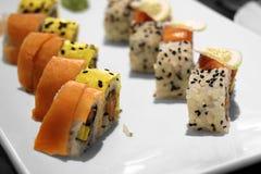 The Japanese national meal rolls. Closeup of Japanese national meal on a white dish Royalty Free Stock Photos