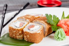Japanese national popular cuisine. Sushi, rice and fish. Tasty, beautifully served food in a restaurant, cafe, with elements of th stock photo