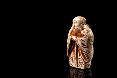 Japanese netsuke. Isolated  on black background Stock Photos
