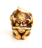 The Japanese netsuke. Japanese netsuke Three wise monkeys, sometimes called the three mystic apes, are a pictorial maxim Stock Photos