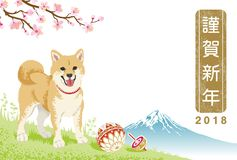 "Japanese New Year card 2018- Shiba inu and toy in Spring nature. Japanese word means ""Happy New Year Stock Photography"