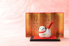 Japanese new year dog object on traditional red paper Stock Photo
