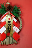 Japanese new year straw rope decoration in the red Stock Photos