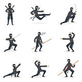 Japanese Ninja Assassin In Full Black Costume Performing Ninjitsu Martial Arts Postures With Different Weapons Series Of Royalty Free Stock Photo