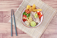 Japanese noodle in tom yam soup topped  steamed streaky pork, Stock Photography
