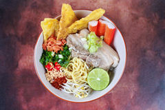 Japanese noodle in tom yam soup topped  steamed streaky pork, Stock Photo