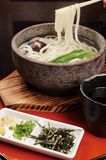 Japanese noodles. Stone bowl and cup Royalty Free Stock Photo