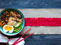 Japanese noodles bowl with chicken, carrots, avocado Stock Images