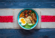 Japanese noodles bowl with chicken, carrots, avocado Stock Photos