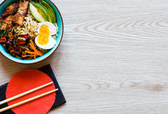 Japanese noodles bowl with chicken, carrots, avocado Stock Photography