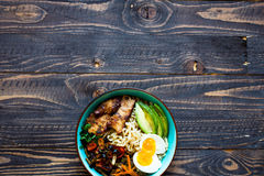 Japanese noodles bowl with chicken, carrots, avocado Royalty Free Stock Images