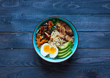 Japanese noodles bowl with chicken, carrots, avocado Stock Image