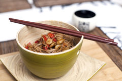 Japanese noodles with chopsticks. A bowl of japanese noodles with shrimps and chopsticks Stock Photography