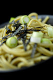Japanese noodles closeup. Detail with black background Royalty Free Stock Images