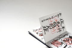 Japanese notebook with stamps and calligraphy Stock Photography