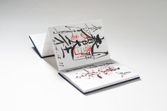 Japanese notebook with stamps and calligraphy Royalty Free Stock Photography