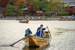 Japanese oar people sail boat at Arashiyama Royalty Free Stock Photo